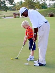 Coach Michael Marshall giving a putting lesson